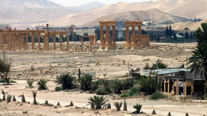 File-This file photo released on Sunday, May 17, 2015, by the Syrian official news agency SANA, shows the general view of the ancient Roman city of Palmyra, northeast of Damascus, Syria. Islamic State militants have blown up one of the most important temples in the ancient Syrian city of Palmyra, accelerating their relentless campaign of destruction against the historical treasures that have fallen under their control, activists and monitors said on Sunday, Aug. 30, 2015. (SANA via AP, File)