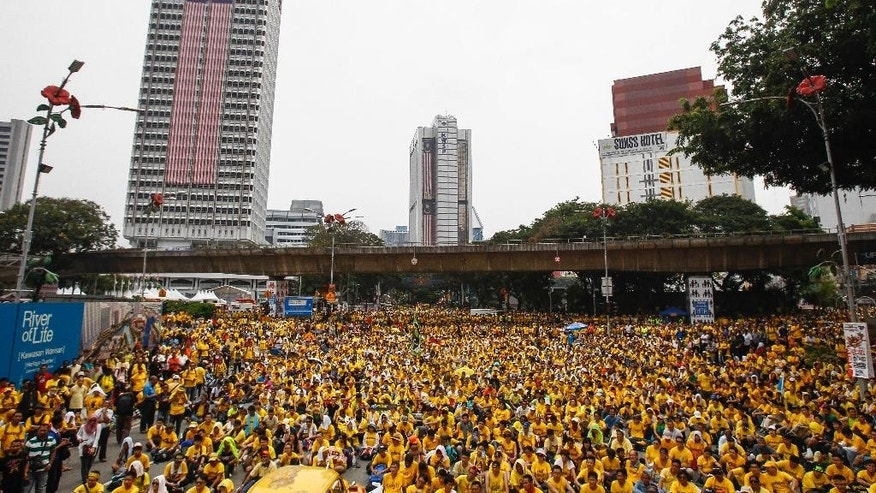 Activists from the Coalition for Clean and Fair Elections (BERSIH) gather on a main road in downtown Kuala Lumpur, Malaysia, during a rally Sunday, Aug. 30, 2015. Big crowds of protesters returned to the streets of Kuala Lumpur on Sunday to demand the resignation of Malaysian Prime Minister Najib Razak over a financial scandal, after the first day of the massive rally passed peacefully. (AP Photo/Joshua Paul)