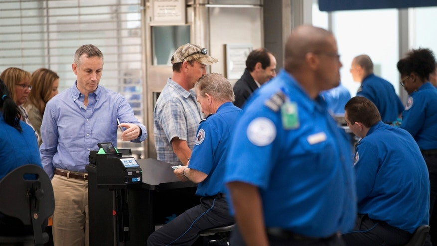CHICAGO, IL - JUNE 02:  Travelers are screened by Transportation Security Administration (TSA) workers at a security check point at O'Hare Airport on June 2, 2015 in Chicago, Illinois. The Department of Homeland Security said that the acting head of the TSA would be replaced following a report that airport screeners failed to detect explosives and weapons in nearly all of the tests that an undercover team conducted at airports around the country.  (Photo by Scott Olson/Getty Images)