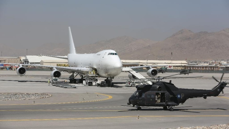 In this Monday, Aug 17, 2015 photo, a U.S. Blackhawk helicopter lands at the NATO Airfield next to the Hamid Karzai International Airport, in Kabul, Afghanistan. A series of airports, built by NATO to fight the Taliban, are being handed over to the Afghan government in a civil aviation upgrade that optimists hope will fuel not only regional trade but even tourism. The eight airfields, worth an estimated $2 billion, are scattered around a landlocked and mountainous land whose lack of rail transport or decent roads makes almost every intercity journey a perilous adventure -- even without factoring in attacks from Taliban militants. (AP Photo/Rahmat Gul)