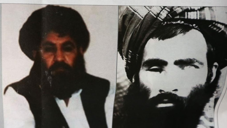 FILE - In this Saturday, Aug. 1, 2015 file photo, an Afghan newspaper headlines pictures of the new leader of the Afghan Taliban, Mullah Akhtar Mansoor, left, and former leader Mullah Mohammad Omar, in Kabul, Afghanistan. Defying the fury of Afghanistan's government and warnings from Washington, Pakistani authorities appear to be turning a blind eye to a meeting of hundreds of Taliban followers in Quetta, Pakistan, near the Afghan border, aimed at resolving a dispute over the group's leadership following the announcement of the death of one-eyed figurehead Mullah Mohammad Omar. (AP Photo/Rahmat Gul, File)