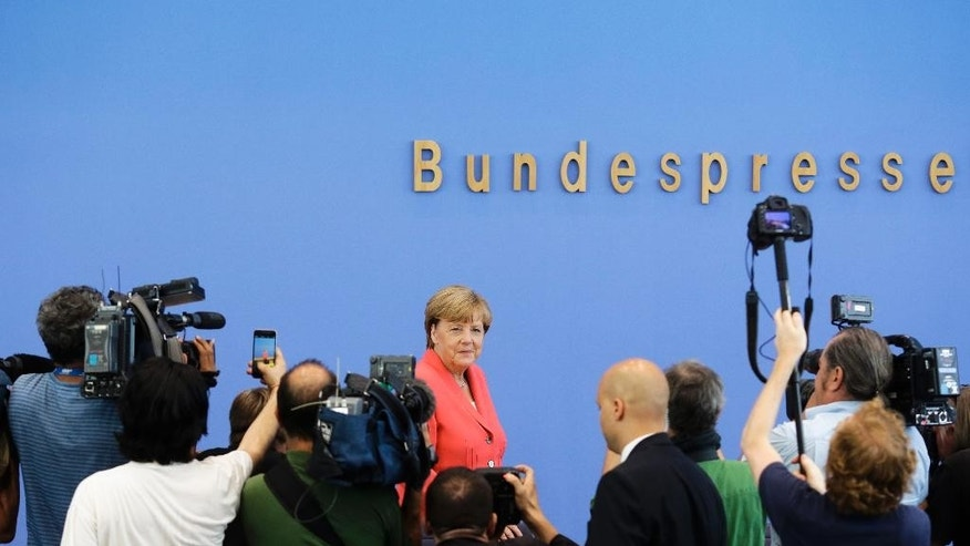 German Chancellor Angela Merkel arrives for her annual summer news conference in Berlin, Monday, Aug. 31, 2015.   (AP Photo/Markus Schreiber)