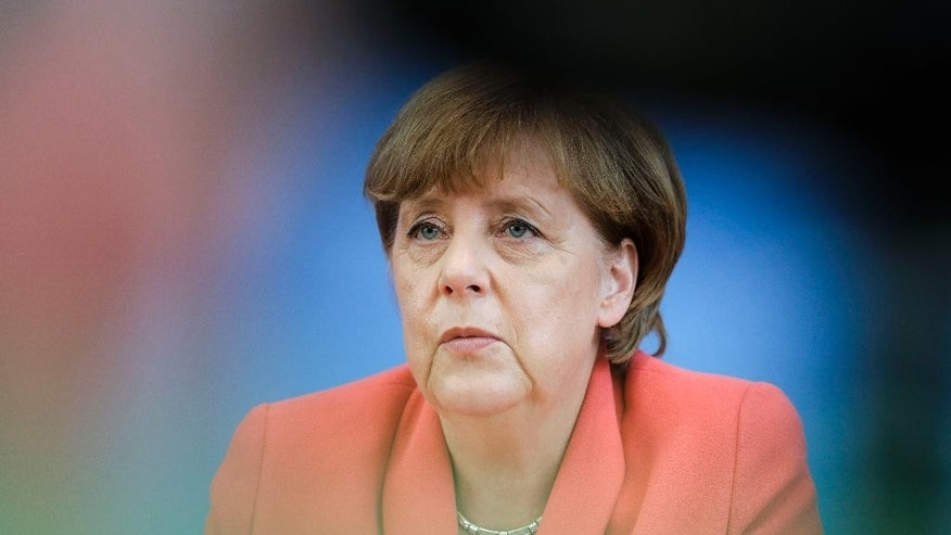 German Chancellor Angela Merkel attends her annual summer news conference in Berlin, Monday, Aug. 31, 2015. (AP Photo/Gero Breloer)