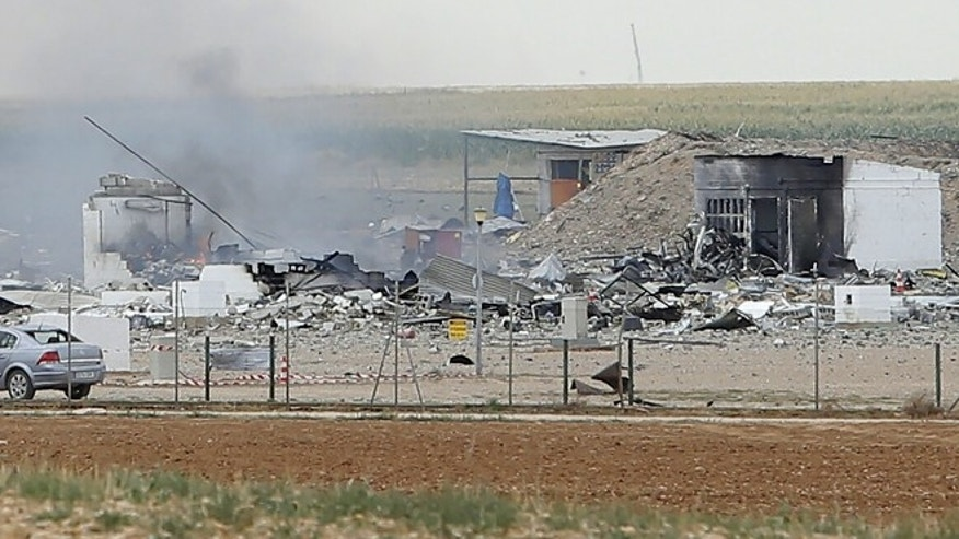 Aug. 31, 2015: Police officers and firefighters stand by the destroyed fireworks factory Pirotecnia Zaragozana's building after a huge explosion  in Pinseque, Spain. The blast at a fireworks factory in northeastern Spain killed a number of people and seriously injured tothers, police and firefighters didn't know the cause of the blast.