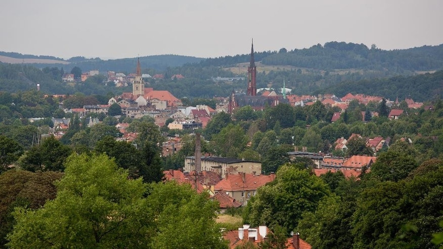 FILE - This  Aug. 28, 2015 file picture shows  a  general view of the city of Walbrzych, Poland, near which a Nazi gold train is believed to be hidden. Polish authorities have blocked off a wooded area near a railroad track after scores of treasure hunters swarmed southwest Poland looking for an alleged Nazi gold train. The city of Walbrzych and its surrounding wooded hills are experiencing a gold rush after two men, informed the authorities through their lawyers that they have found a Nazi train with armaments and valuables that reportedly went missing in the spring of 1945.  (AP Photo/Str)   POLAND OUT