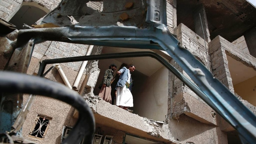Yemeni people inspect a house damaged by a Saudi air strike in Sanaa, Yemen, Monday, Aug. 31, 2015. (AP Photo/Hani Mohammed)