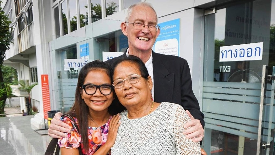 Alan Morison, center, Australian editor of the website Phuketwan, and his colleague Chutima Sidasathian, left, and her mother Krissana Sidasathian, pose for a photo after their acquittal in Phuket, Thailand, Tuesday, Sept. 1, 2015. Morison and Chutima have been cleared of charges of defaming the Thai navy by a court on the island of Phuket. (AP Photo/Dan Miles)