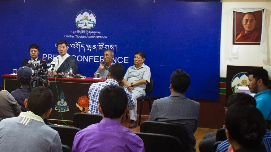 Lobsang Sangay, the prime minister of the Tibetan government-in-exile, seated second left, speaks to media personnel in Dharmsala, India, Tuesday, Sept. 1, 2015. The exiled Tibetan government said it saw no cause for celebrating 50 years since China formed the Tibetan Autonomous Region, insisting that Tuesday instead marked a half-century of occupation and control over the once-independent Himalayan kingdom. (AP Photo/Ashwini Bhatia)