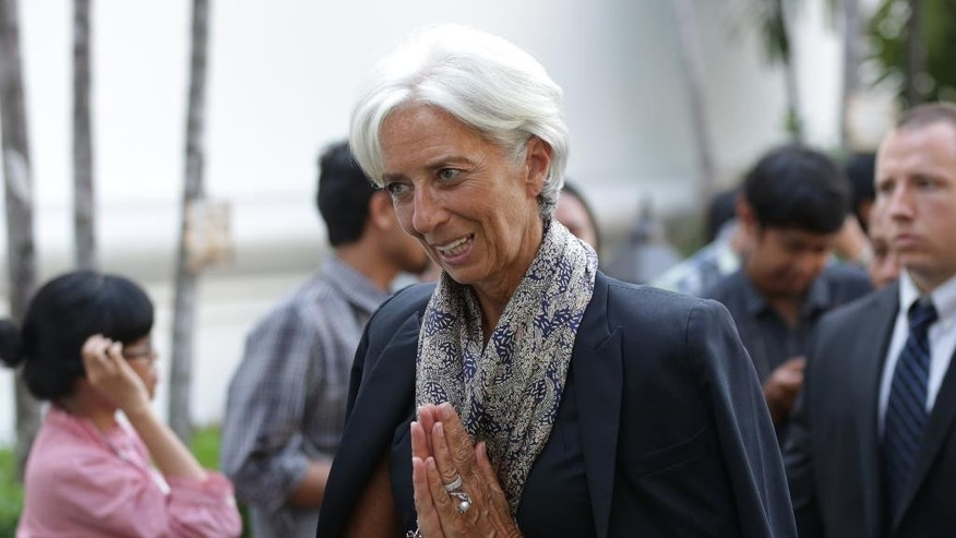 Managing Director of the International Monetary Fund Christine Lagarde gestures to journalists upon arrival at the Presidential Palace in Jakarta, Tuesday, Sept. 1, 2015. Lagarde is on a two-day visit in the country.(AP Photo/Achmad Ibrahim)