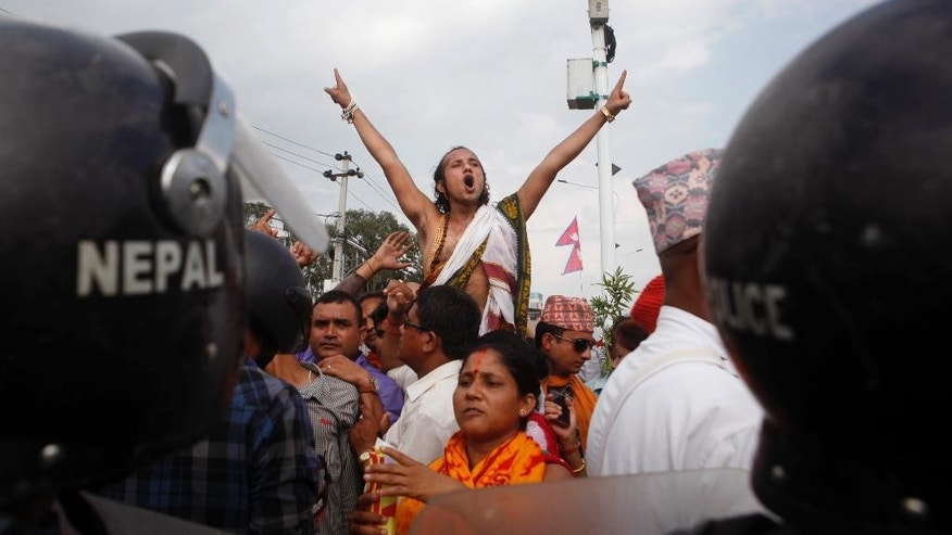 A Nepalese Hindu activist shouts slogans as they try to enter a restricted area near the Nepalese Constituent Assembly Hall during a protest in Kathmandu, Nepal, Tuesday, Sept. 1, 2015. Police in southern Nepal opened fire Tuesday on members of an ethnic group demanding a new state in a draft constitution. (AP Photo/Niranjan Shrestha)