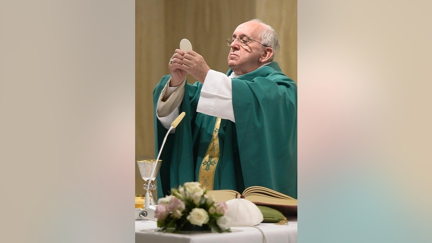 Pope Francis celebrates Mass at the Vatican's Santa Marta hotel, Monday, Sept.1, 2015. (L'Osservatore Romano/Pool Photo via AP)