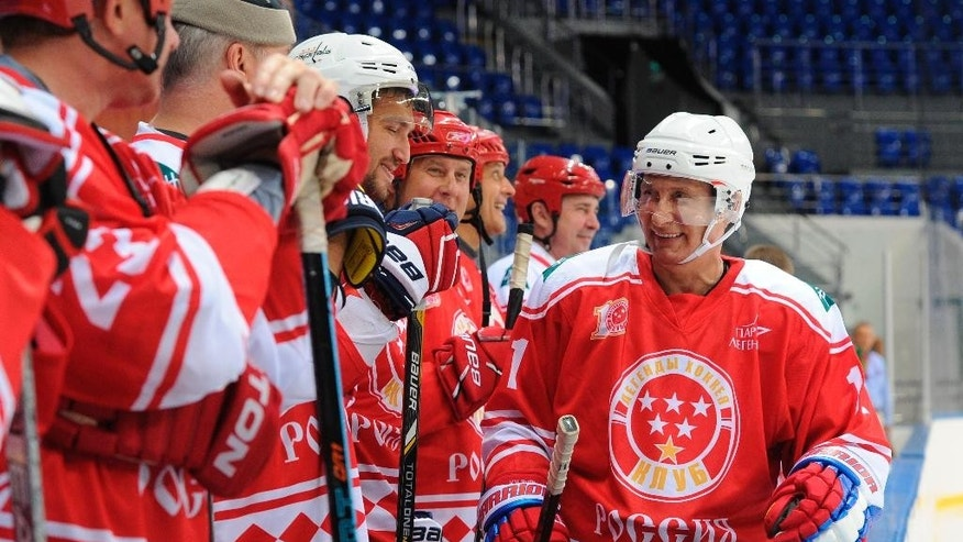 Russian President Vladimir Putin, right, takes part in a match between former Russian ice hockey stars and students of the Sirius college for gifted children in the Black Sea resort of Sochi, Russia, Tuesday, Sept. 1, 2015.  (Mikhail Klimentyev/RIA-Novosti, Kremlin Pool Photo via AP)