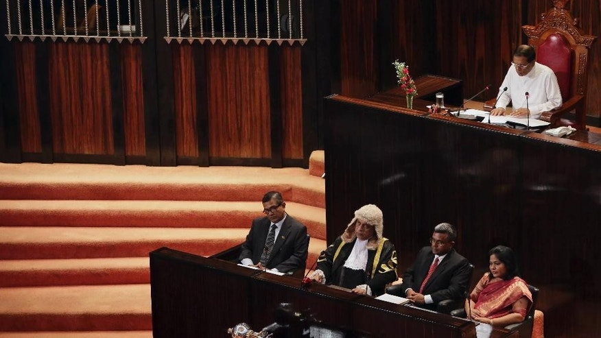 Sri Lanka's President Maithripala Sirisena speaks during his inaugural address to the 225-member parliament at its first meeting in Colombo, Sri Lanka, Tuesday, Sept. 1, 2015. Sirisena asked the country's newly elected lawmakers on Tuesday to draft political reforms to promote ethnic reconciliation and economic development in the post-war era. (AP Photo/Sanka Gayashan)