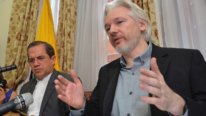 FILE - In this Aug. 18, 2014, file photo, WikiLeaks founder Julian Assange, right,  speaks during a news conference with Ecuador's Foreign Minister Ricardo Patino, inside the Ecuadorian Embassy in London.  Swedish prosecutors on Thursday Aug. 13, 2015  dropped cases of lesser sexual misconduct against WikiLeaks founder Julian Assange but said they still want to question him on accusations of rape made after his visit to Stockholm five years ago.  (John Stillwell/Pool Photo via AP, File)