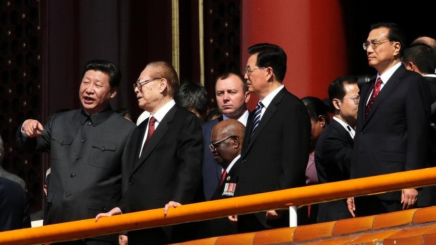Chinese President Xi Jinping, left, stands with from left, former Chinese President Jian Zemin, former Chinese President Hu Jintao and China's Premier Li Keqiang during a parade commemorating the 70th anniversary of Japan's surrender during World War II held in front of Tiananmen Gate, in Beijing, Thursday, Sept. 3, 2015. (AP Photo/Ng Han Guan)