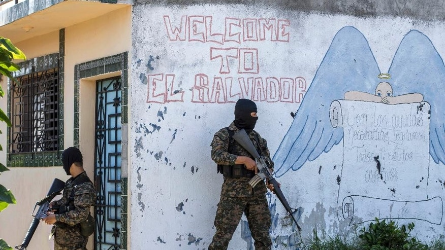 In this Monday, Aug. 31, 2015 photo, soldiers guard a corner in a gang-controlled neighborhood in Ilopango, El Salvador. Figures released by the country's coroner's office confirm the month of August as the deadliest in the country's history.  (AP Photo/Salvador Melendez)
