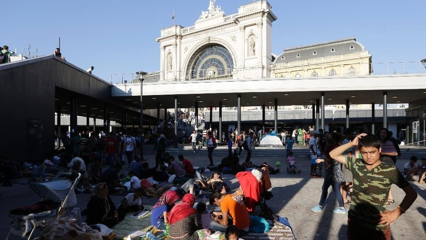 Migrants rest near the Keleti Railway Station in Budapest, Hungary, Wednesday, Sept. 2, 2015, after police stopped them from getting on trains to Germany. Over 150,000 migrants have reached Hungary this year, most coming through the southern border with Serbia. Many apply for asylum but quickly try to leave for richer EU countries. (AP Photo/Petr David Josek)