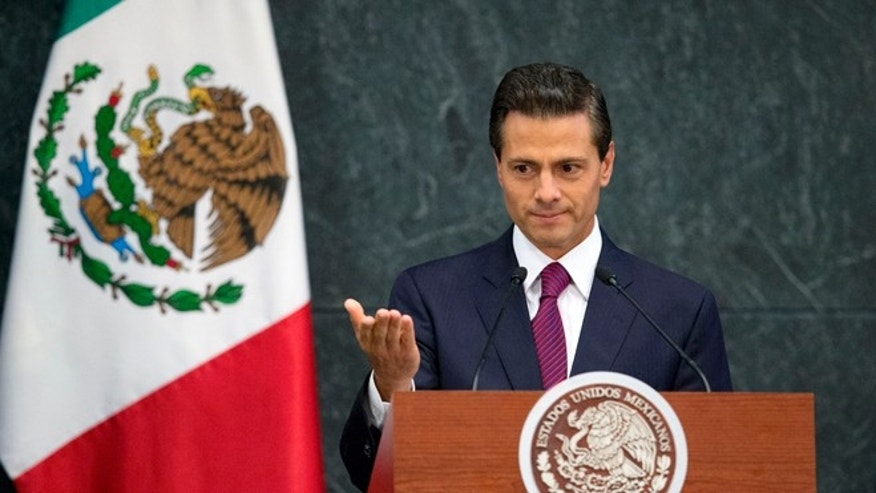 FILE - In this Aug. 27, 2015 file photo, Mexico's President Enrique Pena Nieto speaks during a press conference to announce cabinet changes, at the Los Pinos presidential residence, in Mexico City. Pena Nieto is set to deliver his third state-of-the-nation address on Wednesday, Sept. 2, 2015, amid rising violence, a falling currency and a slowing economy. Pena Nieto shook up his cabinet last week in an apparent attempt to change direction. But tough international market conditions may limit his maneuvering room. (AP Photo/Rebecca Blackwell, File)