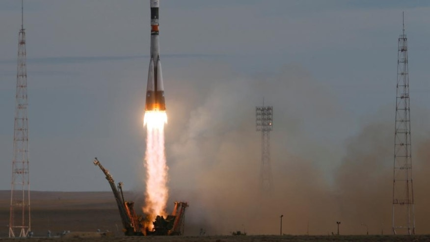 The Soyuz-FG rocket booster with Soyuz TMA-18M space ship carrying a new crew to the International Space Station, ISS, blasts off at the Russian leased Baikonur cosmodrome, Kazakhstan, Wednesday, Sept. 2, 2015. The Russian rocket carries Kazakhstan's cosmonaut Aydyn Aimbetov, Russian cosmonaut Sergei Volkov and Denmark's astronaut Andreas Mogensen. (AP Photo/Dmitry Lovetsky)