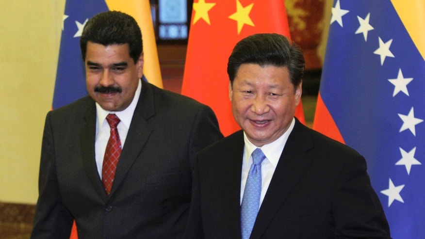Chinese President Xi Jinping, right, walks with Venezuela's President Nicolas Maduro before their meeting at the Great Hall of the People in Beijing, China, Tuesday, Sept. 1, 2015. (Parker Song/Pool Photo via AP)