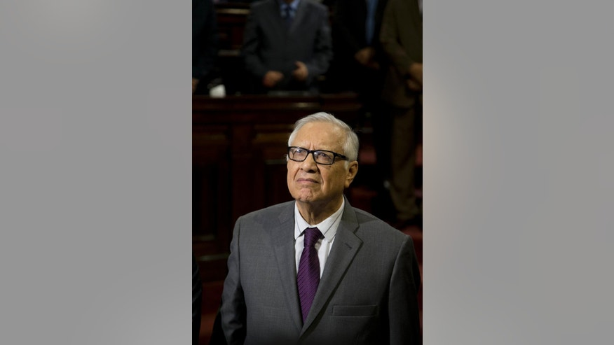 FILE - In this May 14, 2015 file photo, Alejandro Maldonado Aguirre attends his swearing-in ceremony as Guatemala's new vice president, inside Congress in Guatemala City.  President Otto Perez Molina resigned Thursday, Sept. 3, 2015, amid a corruption scandal after a judge issued an order to detain him in the case. Maldonado is constitutionally in line to assume the presidency.  (AP Photo/Moises Castillo, File)
