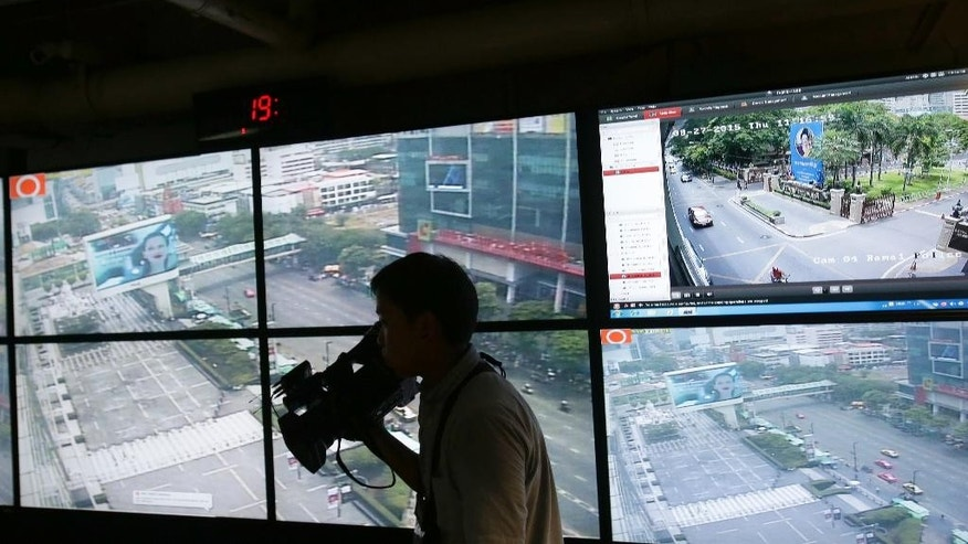 In this Aug. 27, 2015, photo, images from closed circuit video cameras monitor a shopping mall plaza across from the Erawan Shrine, the site of the Aug. 17 bombing, in Bangkok, Thailand. Bangkok's laid-back vibe has toughened a bit in the aftermath of last month's deadly bombing in the heart of the city. Security appears tighter, with a more conspicuous contingent of police, soldiers and plainclothes officers patrolling and guarding tourist areas and public places that attract crowds. (AP Photo/Sakchai Lalit)
