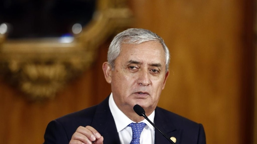 File-This Aug. 31, 2015, file photo shows Guatemala's President Otto Perez Molina speaking during a press conference, in Guatemala City.  A president's spokesman says Molina has resigned in the face of a fraud scandal. Jorge Ortega says Perez Molina submitted his resignation at midnight local time Thursday, Sept. 3, 2015, after a judge issued an order to detain him in a corruption case that has brought his government to the brink. (AP Photo/Moises Castillo, File)