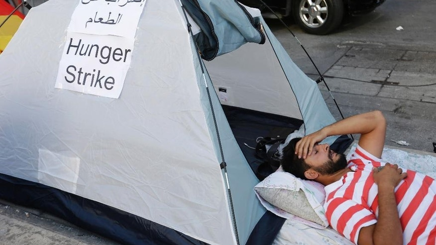 Waref Suleiman, a Lebanese activist, holds a hunger strike with other activists outside the Environment Ministry in downtown Beirut, Lebanon, Thursday, Sept. 3, 2015. Several Lebanese activists launched an open-ended hunger strike on Thursday, demanding the resignation of the environment minister at the center of the country's trash crisis. The activists set up tents outside the Environment Ministry in downtown Beirut. Several supporters joined the 11 hunger strikers Thursday evening. (AP Photo/Hassan Ammar)