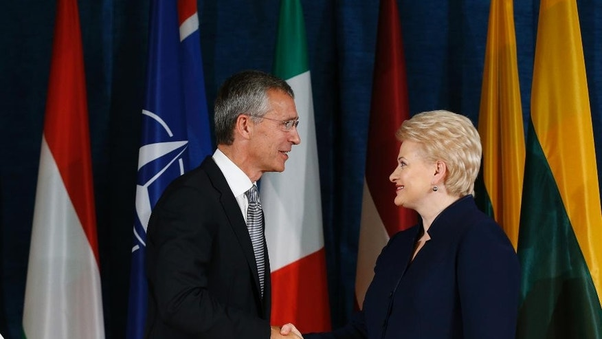 Lithuania's President Dalia Grybauskaite and NATO Secretary General Jens Stoltenberg, left, shake hands at the end of a news conference  at the NATO Force Integration Unit Headquarters in Vilnius, Lithuania, Thursday, Sept. 3, 2015. NATO Force Integration Units are small command and control headquarters whose key mission is to facilitate the rapid deployment of the NATO Very High Readiness Joint Task Force  and additional rapid response elements into the region if needed.  (AP Photo/Mindaugas Kulbis)
