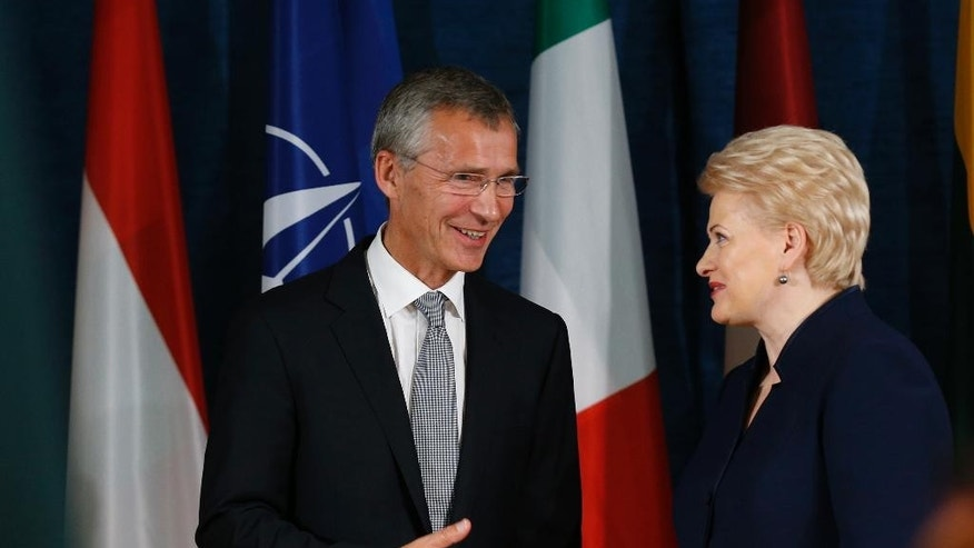 Lithuania's President Dalia Grybauskaite and NATO Secretary General Jens Stoltenberg, left, speaks at the end of a news conference at the NATO Force Integration Unit Headquarters in Vilnius, Lithuania, Thursday, Sept. 3, 2015. NATO Force Integration Units are small command and control headquarters whose key mission is to facilitate the rapid deployment of the NATO Very High Readiness Joint Task Force  and additional rapid response elements into the region if needed.  (AP Photo/Mindaugas Kulbis)