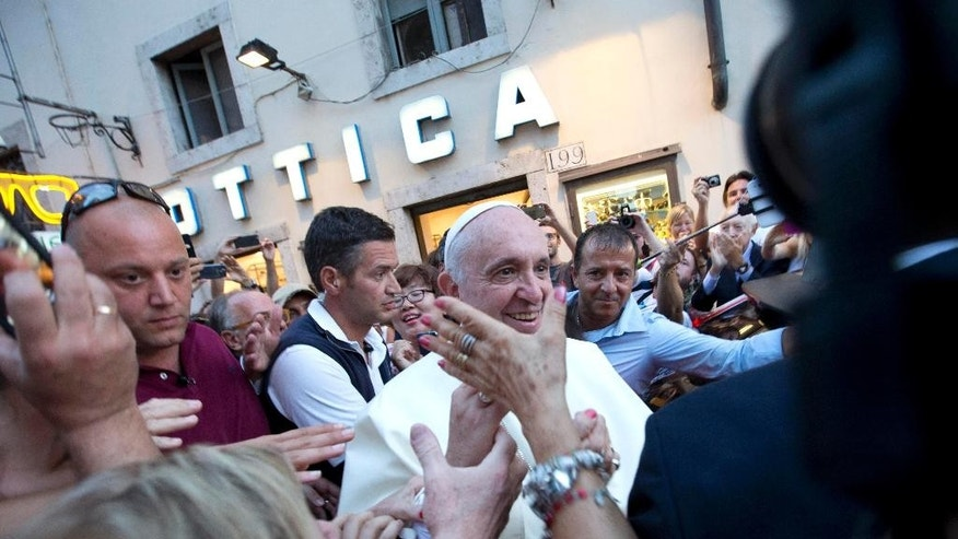Pope Francis leaves an eyeglass store on Via del Babuino, in central Rome, Thursday, Sept. 3, 2015. Pope Francis slipped out of the Vatican Thursday for a personal errand: New glasses. (AP Photo/Alessandra Tarantino)