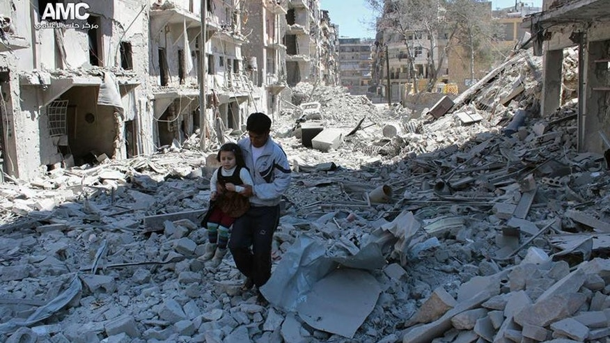 FILE - In This April 21, 2014, file photo, provided by the anti-government activist group Aleppo Media Center (AMC), which has been authenticated based on its contents and other AP reporting, shows a Syrian man holding a girl as he stands on the rubble of houses that were destroyed by Syrian government forces air strikes in Aleppo, Syria.  From the three-year-old boy who washed ashore on a Turkish beach to the 71 migrants who suffocated in a truck in Austria to the daily scenes of chaos unfolding in European cities as governments try to halt a human tide heading north. There is no let up to the horrors that Syria's civil war keeps producing. Syria's brutal conflict, now in its fifth year, has touched off the greatest humanitarian crisis of our time. About 250,000 people have been killed and more than one million wounded since March 2011, according to U.N. officials. (AP Photo/Aleppo Media Center AMC, File)