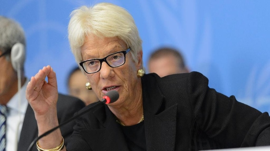 Carla del Ponte, Member of the Commission of Inquiry on the Syrian Arab Republic, speaks during a press conference about the launch of latest report by the Commissionto the Human Rights Council, at the European headquarters of the United Nations, in Geneva, Switzerland, Thursday, Sept, 3,  2015.  (Martial Trezzini/Keystone via AP)