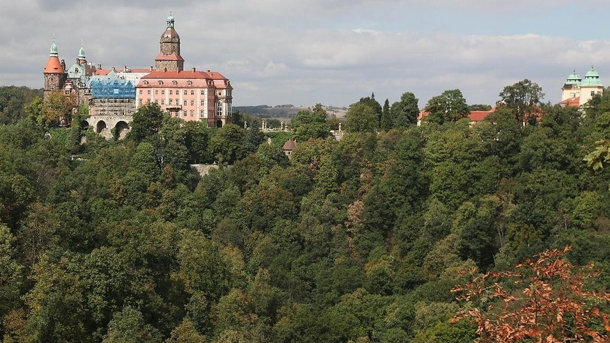 "A view of Ksiaz Castle in Walbrzych, Poland, on Wednesday, Sept. 2, 2015. Polish authorities recently said that two unidentified men used radar to locate an armored train deep under the woodlands around Walbrzych, and believe it could be the so-called Nazi ""gold train."" Rumors have swirled for decades about the train, also said to be filled with weapons, though there is absolutely no evidence that it ever existed. (AP Photo/Czarek Sokolowski)"