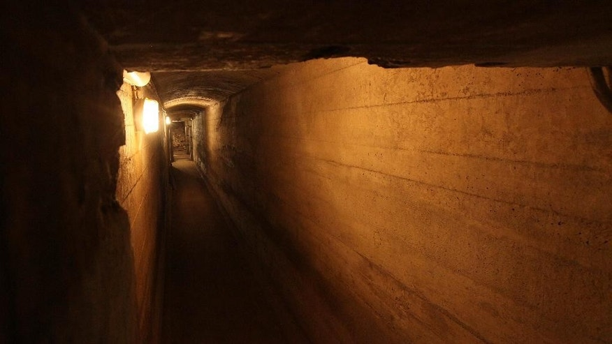 "An evacuation tunnel under Ksiaz Castle in Walbrzych, Poland on Wednesday, Sept. 2, 2015 that the Nazis built most probably for Adolf Hitler, leading to massive shelters that are part of a giant system of tunnels and bunkers around Walbrzych and believed by some explorers to hold a gold train that the Nazis allegedly hid in 1945 from the Red Army. Polish authorities recently said that two unidentified men used radar to locate an armored train deep under the woodlands around Walbrzych, and believe it could be the so-called Nazi ""gold train."" Rumors have swirled for decades about the train, also said to be filled with weapons, though there is absolutely no evidence that it ever existed. (AP Photo/Czarek Sokolowski)"