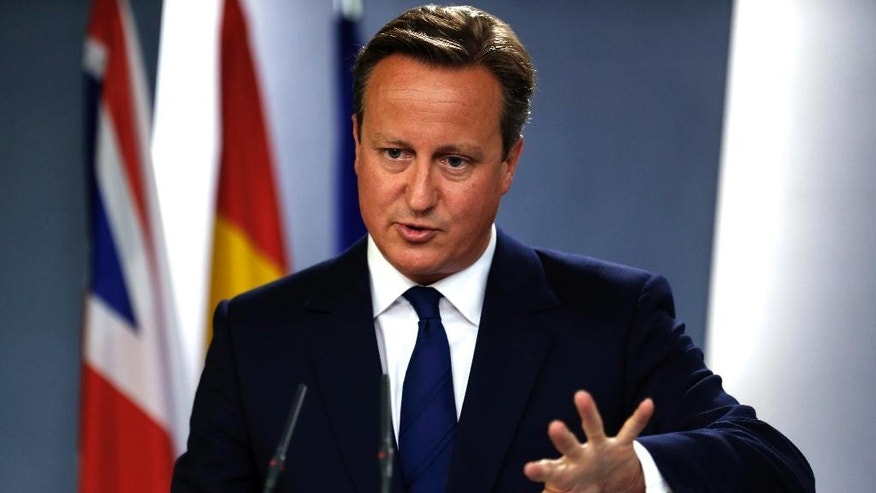 Britain's Prime Minister David Cameron talks to journalists during a joint news conference with his Spanish counterpart Mariano Rajoy after their meeting at the Moncloa Palace in Madrid, Spain, Friday, Sept. 4, 2015. Cameron was on Spain for an official visit after meeting his Portuguese counterpart Pedro Passos Coelho in Lisbon on Friday morning. (AP Photo/Francisco Seco)