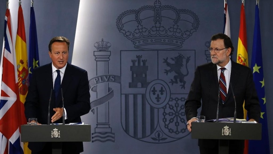 Britain's Prime Minister David Cameron, left, talks to journalists during a joint news conference with his Spanish counterpart Mariano Rajoy after their meeting at the Moncloa Palace in Madrid, Spain, Friday, Sept. 4, 2015. Cameron was on Spain for an official visit after meeting his Portuguese counterpart Pedro Passos Coelho in Lisbon on Friday morning. (AP Photo/Francisco Seco)
