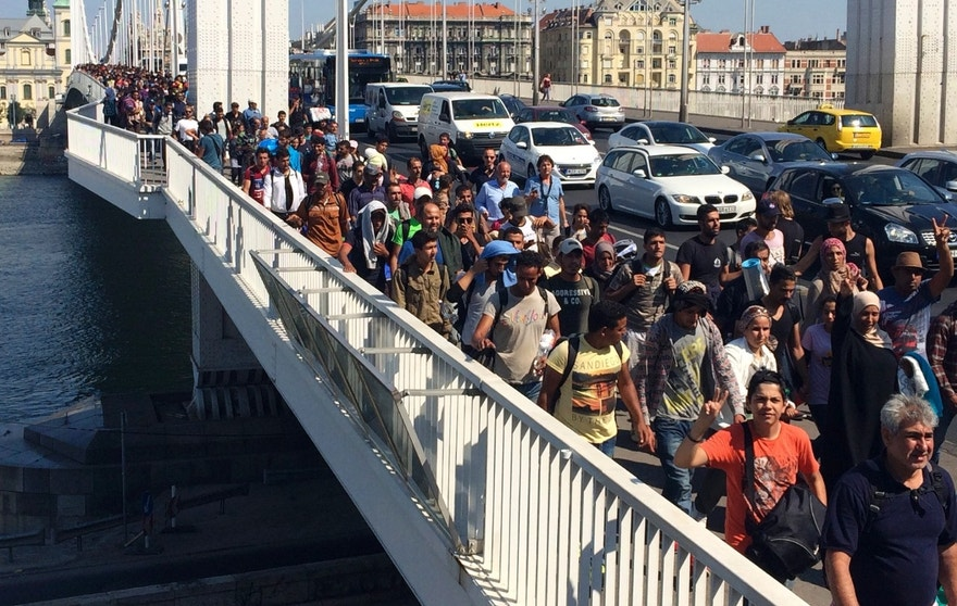 Sept, 4, 2015 - Hundreds of migrants cross the river Danube in Budapest, after deciding to walk toward Austria. Thousands have been camped out at Budapest's Keleti train station for days, before they decided to try to reach their destination on foot.