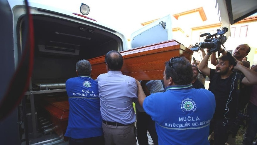 Sept. 3, 2015 - Officials carry the coffin of Rehan Kurdi-- the mother of Syrian boys Aylan, 3, and Galip, 5, who were washed up drowned on a beach near the Turkish resort of Bodrum Wednesday-- from a morgue to a funeral car in Mugla, Turkey.