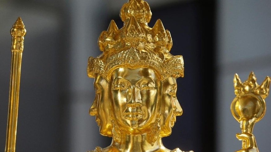 The restored statue of Phra Phrom, the Thai interpretation of the Hindu god Brahma stands in Bangkok, Thailand, Friday, Sept. 4, 2015. Thai authorities unveiled the restored centerpiece Friday of the Erawan Shrine, in the latest bid to restore confidence among Bangkok's tourism and business communities almost three weeks after a deadly bombing. (AP Photo/Sakchai Lalit)