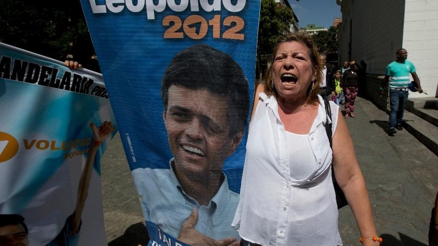 "A supporter of Leopoldo Lopez shouts ""Freedom for Leopoldo"" while holding his poster outside court in Caracas, Venezuela, Friday, Sept. 4, 2015. The 19-month trial of the Venezuelan opposition leader is coming to a close on Friday as the imprisoned politician prepares to give his final remarks in a closed courtroom. Lopez is charged with inciting violence in his role as leader of a bloody protest movement in 2014, and could face more than 10 years in prison. (AP Photo/Fernando Llano)"