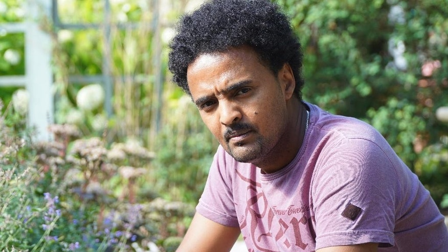 Eritrean refugee Adal Neguse  in this photo taken Aug. 21, 2015, in Stockholm, Sweden, who has now gained Swedish citizenship. Adal's brother died in the Oct. 3, 2013, tragedy in Lampedusa, Italy and faced long delays in having the death of his brother officially confirmed and told the place of his burial. (AP Photo/ David Keyton)