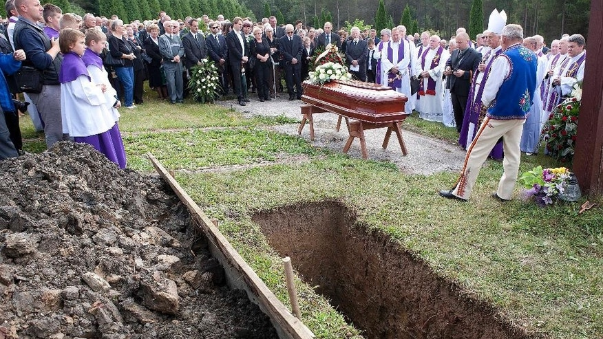 Mourners gather for the burial of Jozef Wesolowski, a former archbishop accused of abusing teenage boys, in Czorsztyn, Poland, on Saturday, Sept. 5, 2015.  Wesolowski died at age on 67 on Aug. 27. A Vatican court charged Wesolowski of sexually abusing boys in the Dominican Republic and possessing large amounts of child pornography. In July a trial began against Wesolowski but it was abruptly adjourned to an undetermined later date due to his falling ill on the eve of the start. (AP Photo)   POLAND OUR