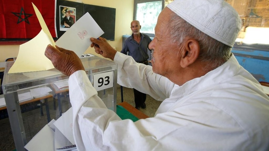 A Moroccan man casts his ballot in a polling station for municipal elections in Casablanca, Morocco, Friday Sept. 4, 2015. Moroccans are voting in regional and communal elections, the first since the central government gave its regions greater autonomy. (AP Photo/Abdeljalil Bounhar)