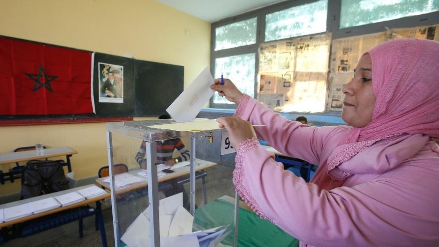 A Moroccan woman casts her ballot in a polling station for the municipal elections in Casablanca, Morocco, Friday Sept. 4, 2015. Moroccans are voting in regional and communal elections, the first since the central government gave its regions greater autonomy. (AP Photo/Abdeljalil Bounhar)