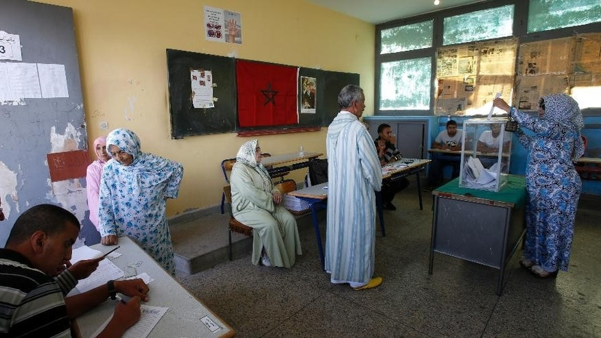A Moroccan woman casts her ballot in a polling station for municipal elections in Casablanca, Morocco, Friday Sept. 4, 2015. Moroccans are voting in regional and communal elections, the first since the central government gave its regions greater autonomy. (AP Photo/Abdeljalil Bounhar)