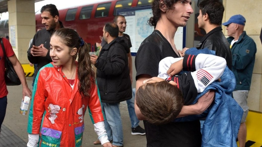 Migrants arrive at the Westbahnhof station in Vienna, Austria, Saturday, Sept. 5, 2015, where they came from Hungary as Austria in the early-morning hours said it and Germany would let them in.  (AP Photo/Hans Punz)