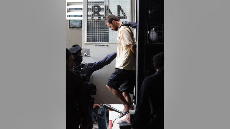 The suspect who was arrested at an apartment last week and found with evidence police said included bomb making equipment and stacks of fake passports is brought to court in the Min Buri district of Bangkok, Thailand, to extend his detention by police on Saturday, Sept. 5, 2015, after he was handed over from military custody on Friday. The suspect's identity has not been confirmed. The Aug. 17 blast at the shrine popular among locals and tourists alike left 20 people dead and more than 120 injured in one of the most devastating acts of violence that the Thai capital had seen in decades. (AP Photo/Wason Wanichakorn)