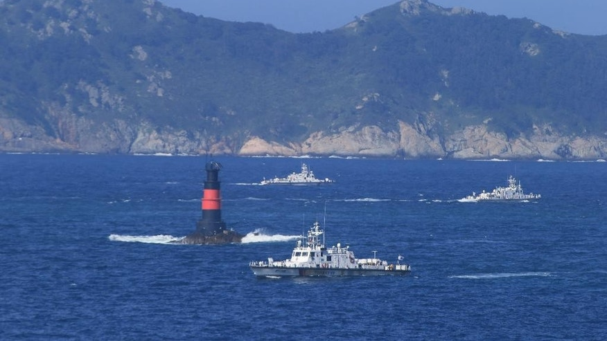 South Korean Coast Guard ships sail to search for missing passengers who were on a capsized fishing boat in the water off north of the resort island of Jeju, South Korea, Sunday, Sept. 6, 2015. The 9.8-ton boat, Dolphin, lost communication with officials on Saturday evening and was found Sunday morning north of the resort island of Jeju. (Park Ji-ho/Yonhap via AP) KOREA OUT