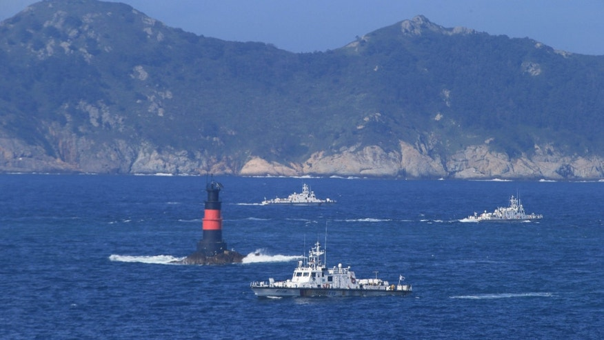 Sept. 6, 2015: South Korean Coast Guard ships sail to search for missing passengers who were on a capsized fishing boat in the water off north of the resort island of Jeju, South Korea.